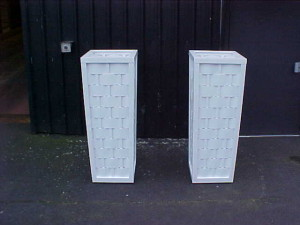A pair of tapered woven ply pot plant stands.